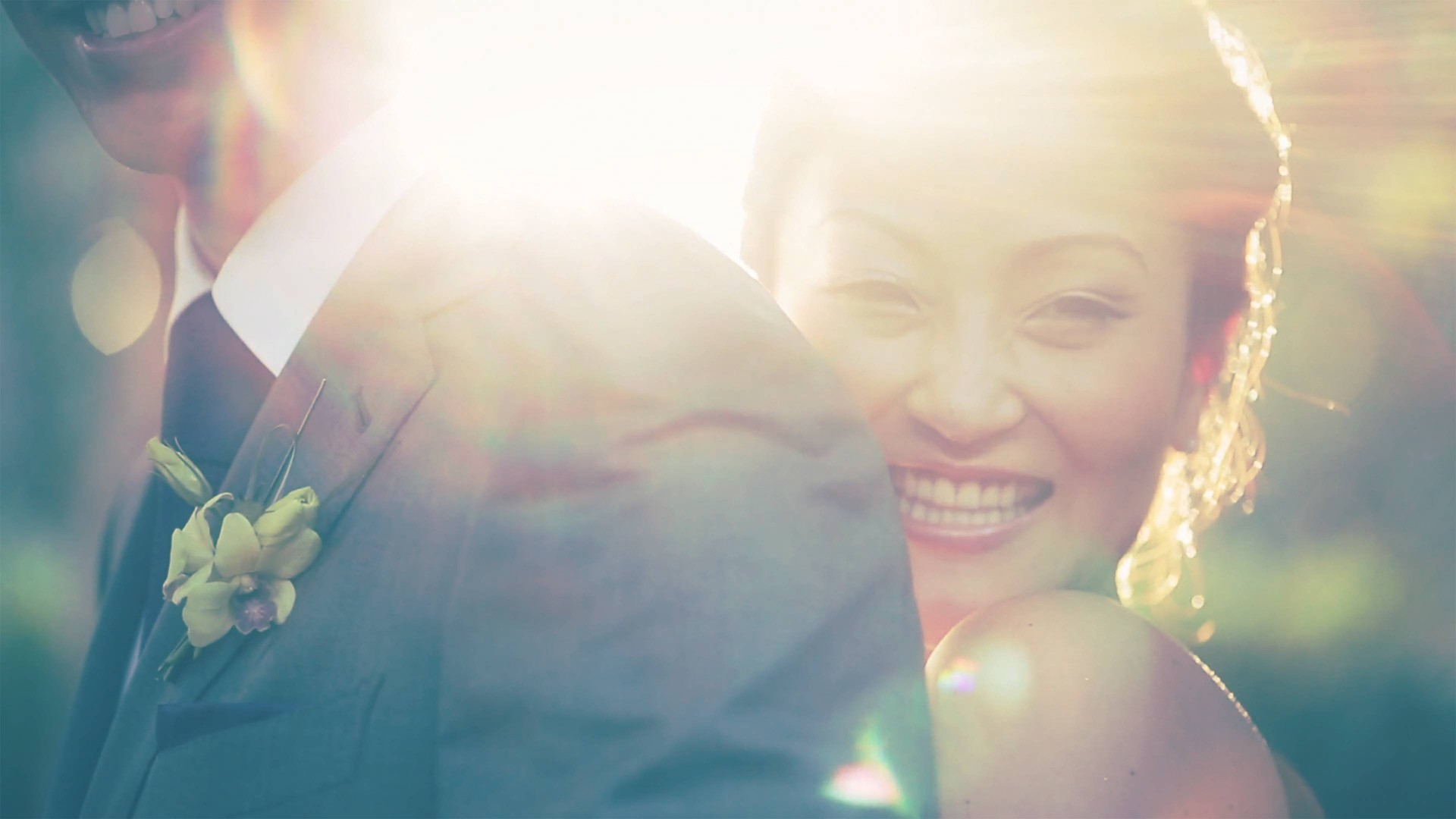 Toned photo of women smiling with sun flare behind her